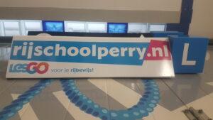 rijschoollesgo dakbord bestickering