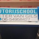 Autorijschool van gils dakbord lesbord
